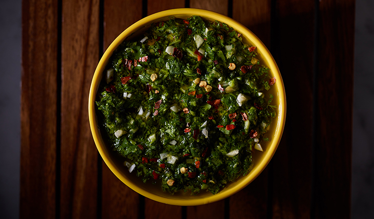 Chimichurri sauce in a yellow bowl