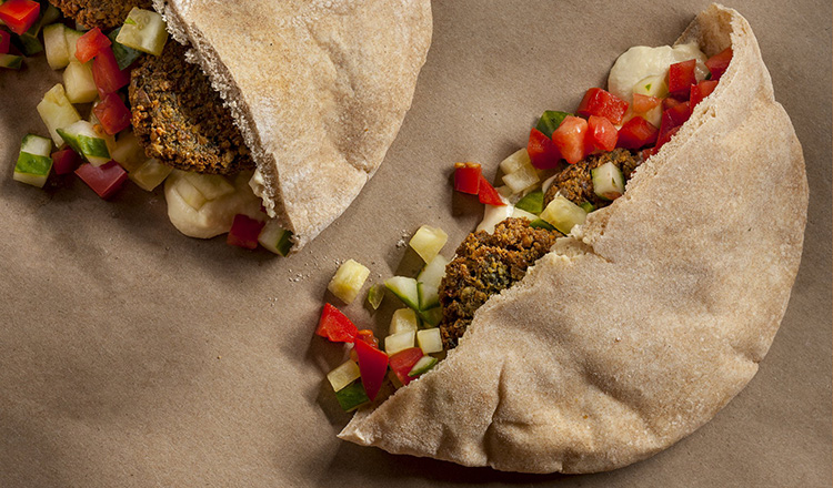 Pita stuffed with falafel, diced cucumber, diced tomato and hummus