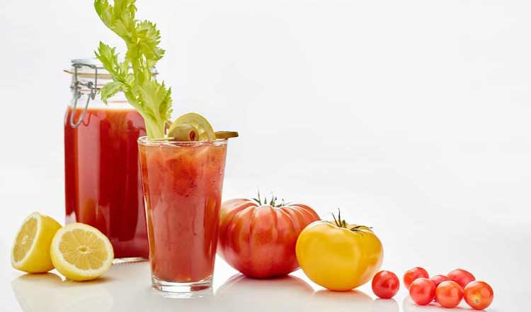 Tomatoes and Bloody Mary drinks made with tomatoes