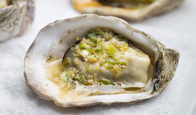 Grilled oysters with scallion butter