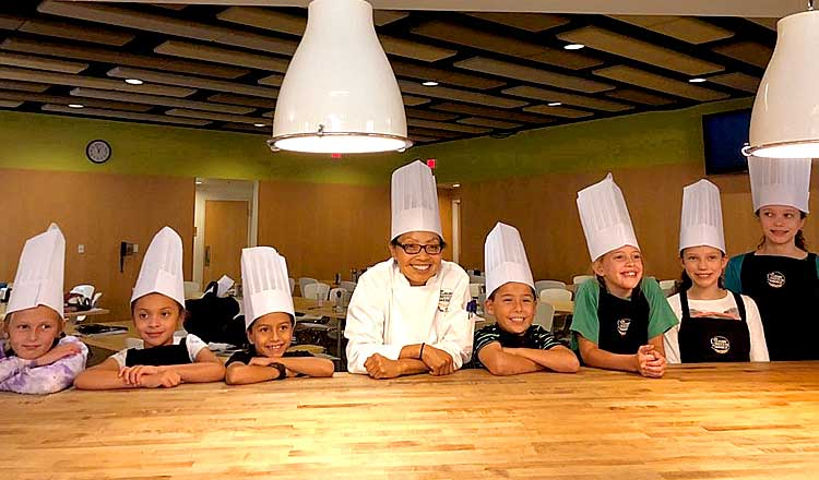 kids and chef in a family class