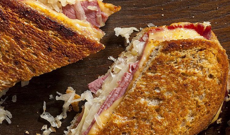 Reuben sandwich cut in half