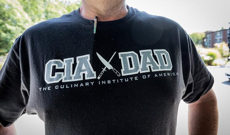 Man in CIA DAD t-shirt