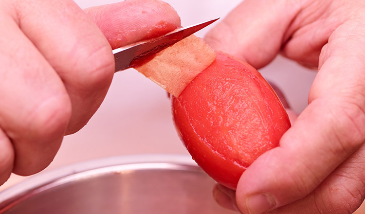 Blanching and peeling tomatoes.