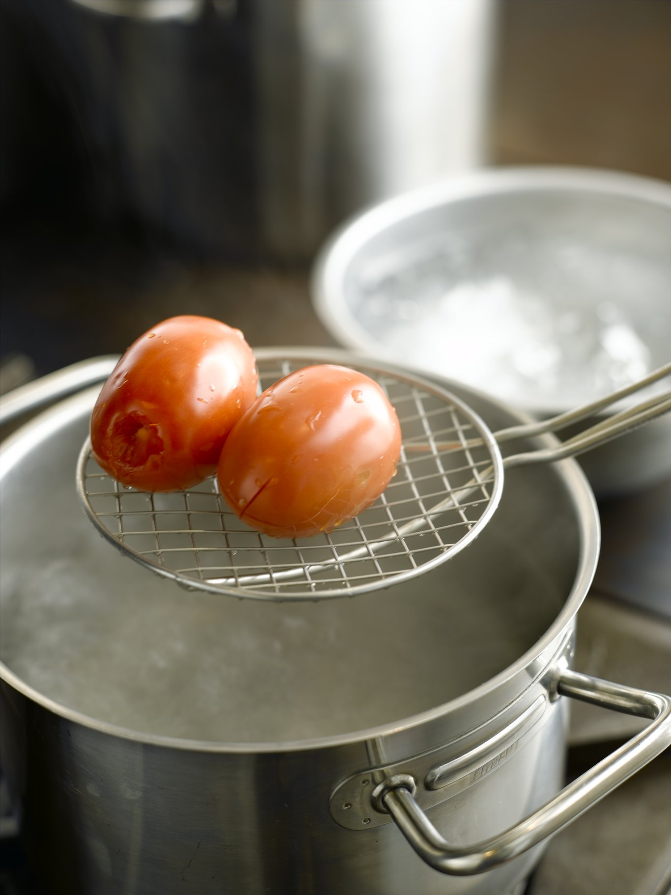 After leaving the tomatoes in boiling water for 10 to 15 seconds, remove with slotted spoon, skimmer, or spider.