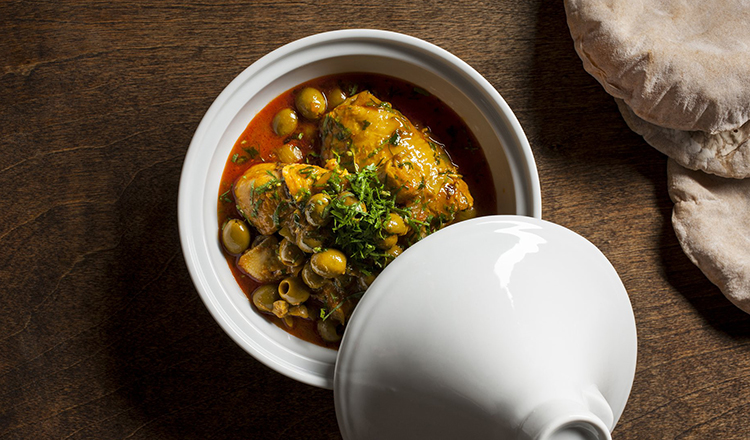 Chicken thighs with green olives in a white tagine