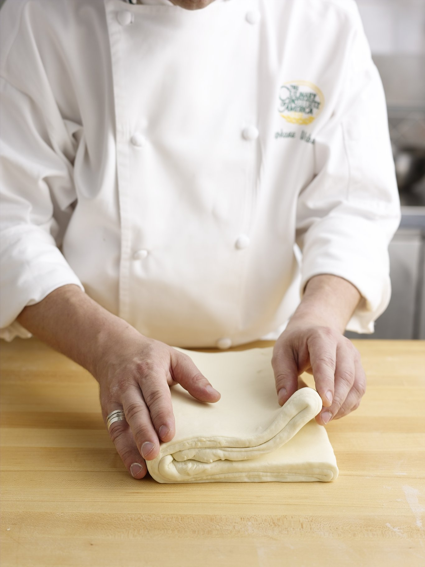 Folding the pastry dough using the four-fold, or book-fold method.