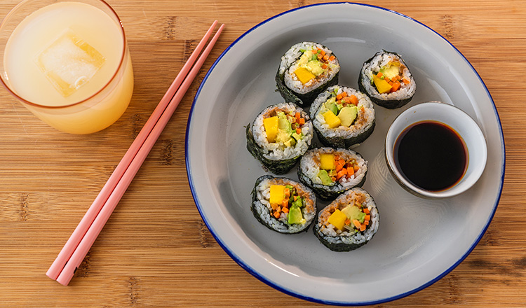Sushi with almond butter, carrots, avocado, and mango.
