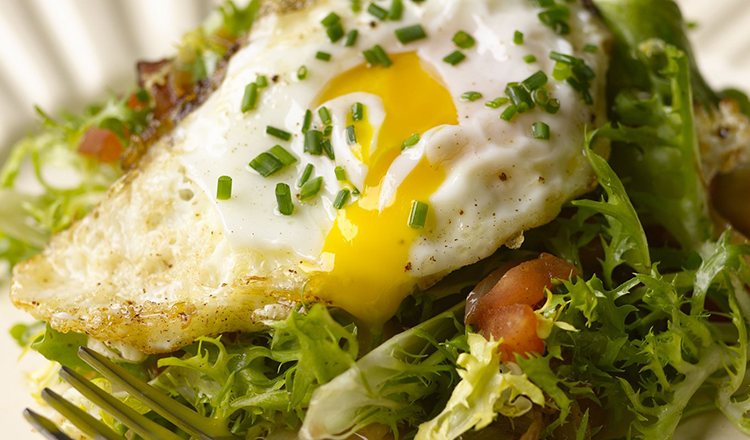 Frisee Salad with Olive Oil Poached Egg and Lardons.