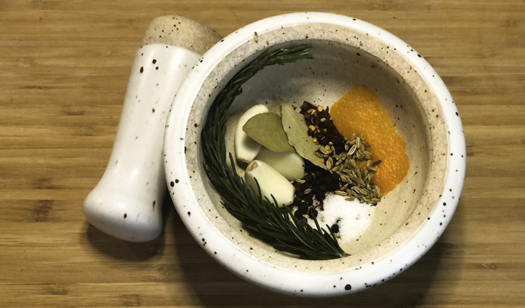 Ingredients for herb rub in mortar and pestle