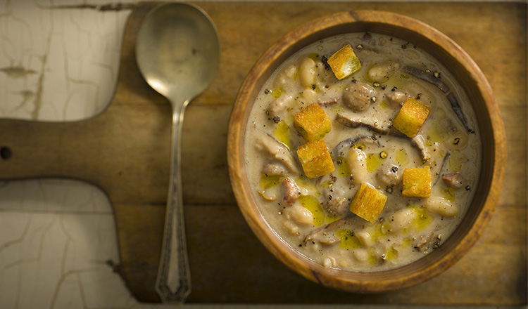 Chestnut, bean and milk soup with mushrooms and rustic croutons.