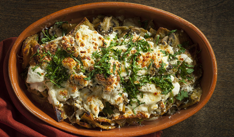 Tortilla, mushroom in a chili sauce smothered in a queso fresco and a queso manchego and baked