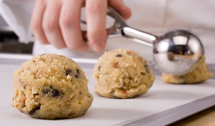 Scooping cookie dough