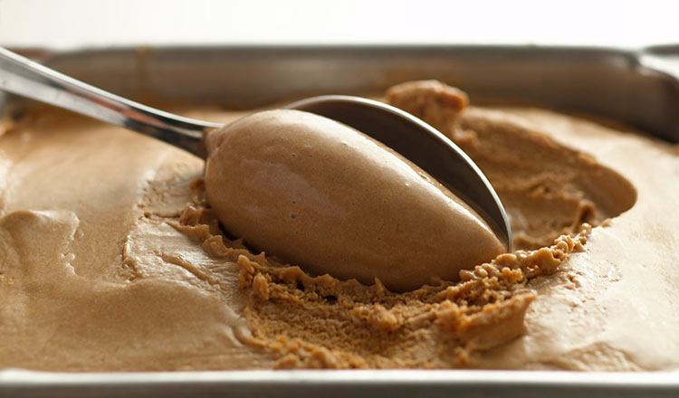 Coffee ice cream being scooped with a spoon