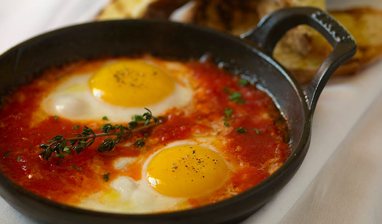 Eggs poached in tomato sauce in a cast-iron pan