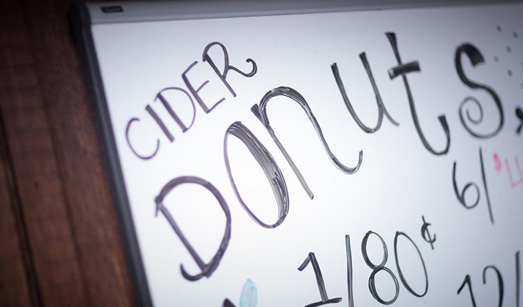 Cider donut sign at a Hudson Valley farmers market