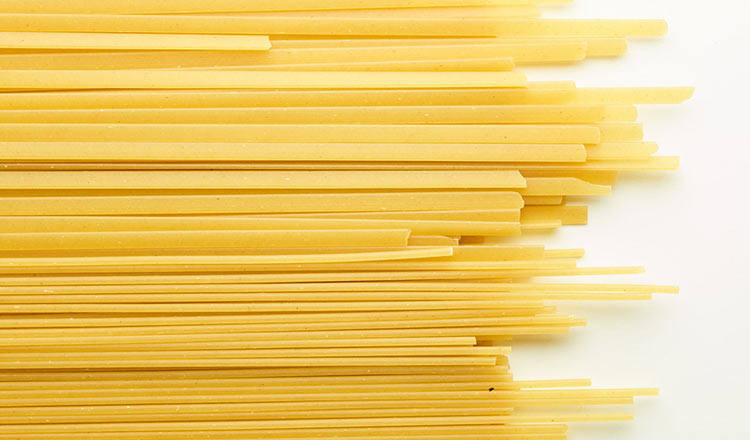 Dried pasta on a white surface